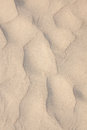 Closeup of sand pattern of a beach in the summer texture Royalty Free Stock Image