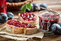 Closeup of sandwich with fresh plum jam on old wooden table Stock Images