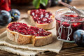 Closeup of sandwich with fresh plum jam on old wooden table Stock Image