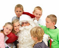 Closeup of  Santa Claus with children isolated Stock Photo