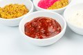 Closeup of sauces in white bowls barbecue tomato sauce bowl Royalty Free Stock Image