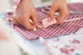 Closeup on seamstress making marks on fabric table Royalty Free Stock Images