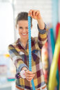 Closeup on seamstress using measuring tape Royalty Free Stock Photo