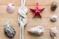 Closeup of seashells, starfish and marine knot lying on boards Royalty Free Stock Photo
