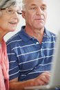 Closeup of a senior man and woman using a laptop Royalty Free Stock Images
