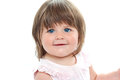 Closeup shot of a chubby female kid with blue eyes Royalty Free Stock Photo