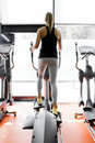 Closeup shot of legs of a female using elliptical trainer in gym Stock Photography