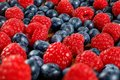 Closeup shot of mixed blueberries and raspberries. Royalty Free Stock Photo