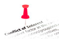 Closeup shot over words conflict of interest on paper pinned white with red pushpin copy space available business concept Royalty Free Stock Images