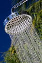Closeup of a shower head with sprinkling water. Royalty Free Stock Image