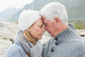 Closeup side view of a romantic senior couple together on rocky landscape Royalty Free Stock Image