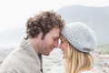 Closeup side view of a romantic young couple together against the mountain Royalty Free Stock Images