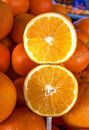 Closeup of sliced oranges on stick in market Royalty Free Stock Photo
