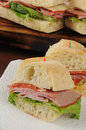 Closeup slices ham pepperoni submarine sandwich Stock Photography
