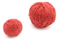 Closeup of small and big red wool ball. White background Royalty Free Stock Photo