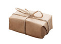 Closeup of small parcel wrapped with kraft paper and rough twine isolated on white Royalty Free Stock Photography