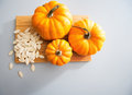 Closeup on small pumpkins and seeds on table in kitchen Stock Images