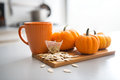 Closeup on small pumpkins seeds and tea bag Royalty Free Stock Photo