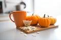 Closeup on small pumpkins seeds and tea bag table Royalty Free Stock Photo