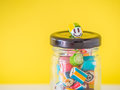 Closeup at smiley face candy cane put on the top of glass jar Royalty Free Stock Photo