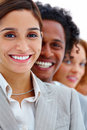 Closeup of smiling business people in a row Stock Photo