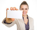 Closeup on smiling business woman showing business card high resolution photo Stock Image
