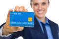 Closeup on smiling business woman showing credit card Royalty Free Stock Photo