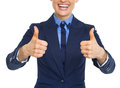 Closeup on smiling business woman showing thumbs up high resolution photo Royalty Free Stock Photos