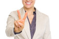 Closeup on smiling business woman showing victory gesture Royalty Free Stock Photo