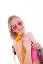 Closeup smiling pretty woman holding yellow flower isolated on white background Stock Photos
