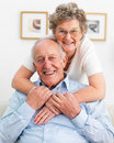 Closeup of a smiling senior couple hugging Stock Image