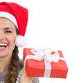 Closeup on smiling woman holding Christmas present Royalty Free Stock Photo