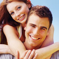 Closeup of a smiling woman hugging young man Stock Photography