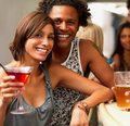 Closeup of a smiling young couple in a bar Royalty Free Stock Images