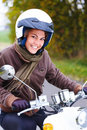Closeup of a smiling young woman riding moped Royalty Free Stock Photography
