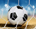 Closeup soccer ball ground near goal area Royalty Free Stock Photos