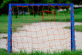 Closeup of soccer goalpost children playground blue with red net Royalty Free Stock Photo