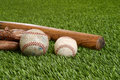 Closeup soft ball and hardball on grass Royalty Free Stock Image