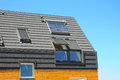 Closeup of Solar Water Panel Heating, Dormers, Solar Panels, Skylights. Passive House Building Concept. Royalty Free Stock Photo