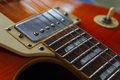 Closeup of solid body electric guitar. Detail, selective focus, low key. Royalty Free Stock Photo