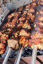 Closeup of some meat skewers being grilled in a barbecue Royalty Free Stock Photo