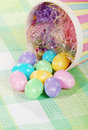 Closeup spilled easter eggs and colorful basket Stock Photo