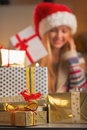 Closeup on stack of christmas present boxes and teenage girl in background Royalty Free Stock Photo