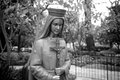 Closeup statue of blessed virgin stands in a garden the san fernando mission Stock Photography