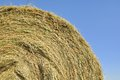 Closeup on straw bale under blue sky Royalty Free Stock Images