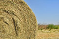 Closeup on straw bale under blue sky Royalty Free Stock Image