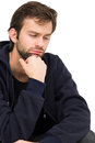 Closeup of a stressed handsome young man over white background Stock Photography