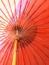 Closeup the structure of the red beach umbrella old made of wooden for protected sunlight Royalty Free Stock Photo