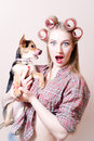 Closeup on surprised pinup sexy blond young beautiful woman holding a dog in her arms looking at camera portrait amazed or girl Royalty Free Stock Photography