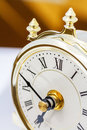 Closeup of table period clock face with oscillating mechanism Stock Photo